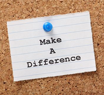 Make a difference written on paper tacked to bulletin board