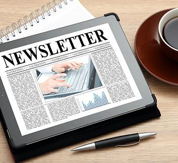 Newsletter on tablet with coffee cup