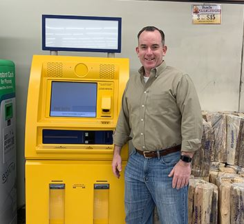 Photo of Matt Crane next to the kiosk at the Aurora King Soopers store
