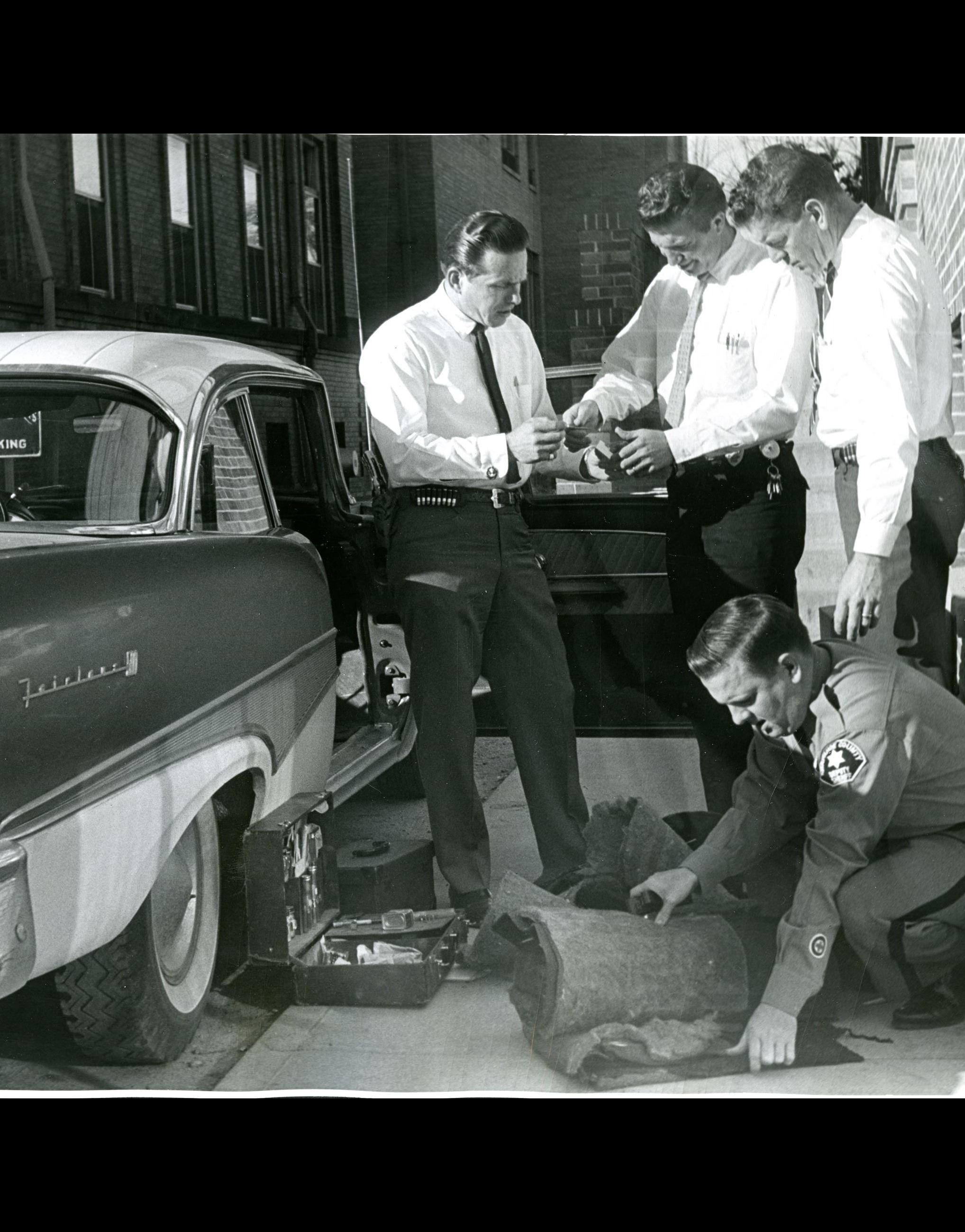 ACSO Investigators and ID Tech process a vehicle at Littleton H.Q. Dec 1961