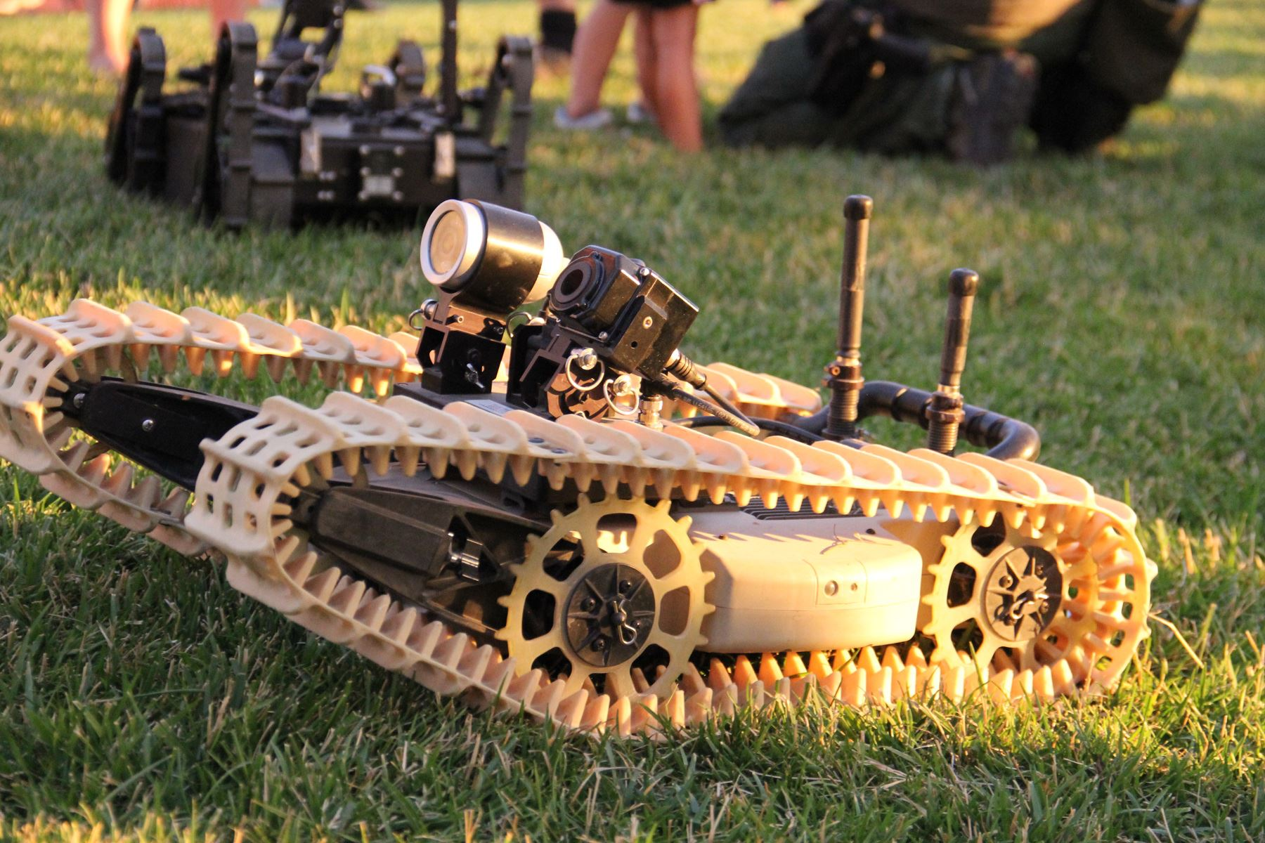 Small bomb robot on grass