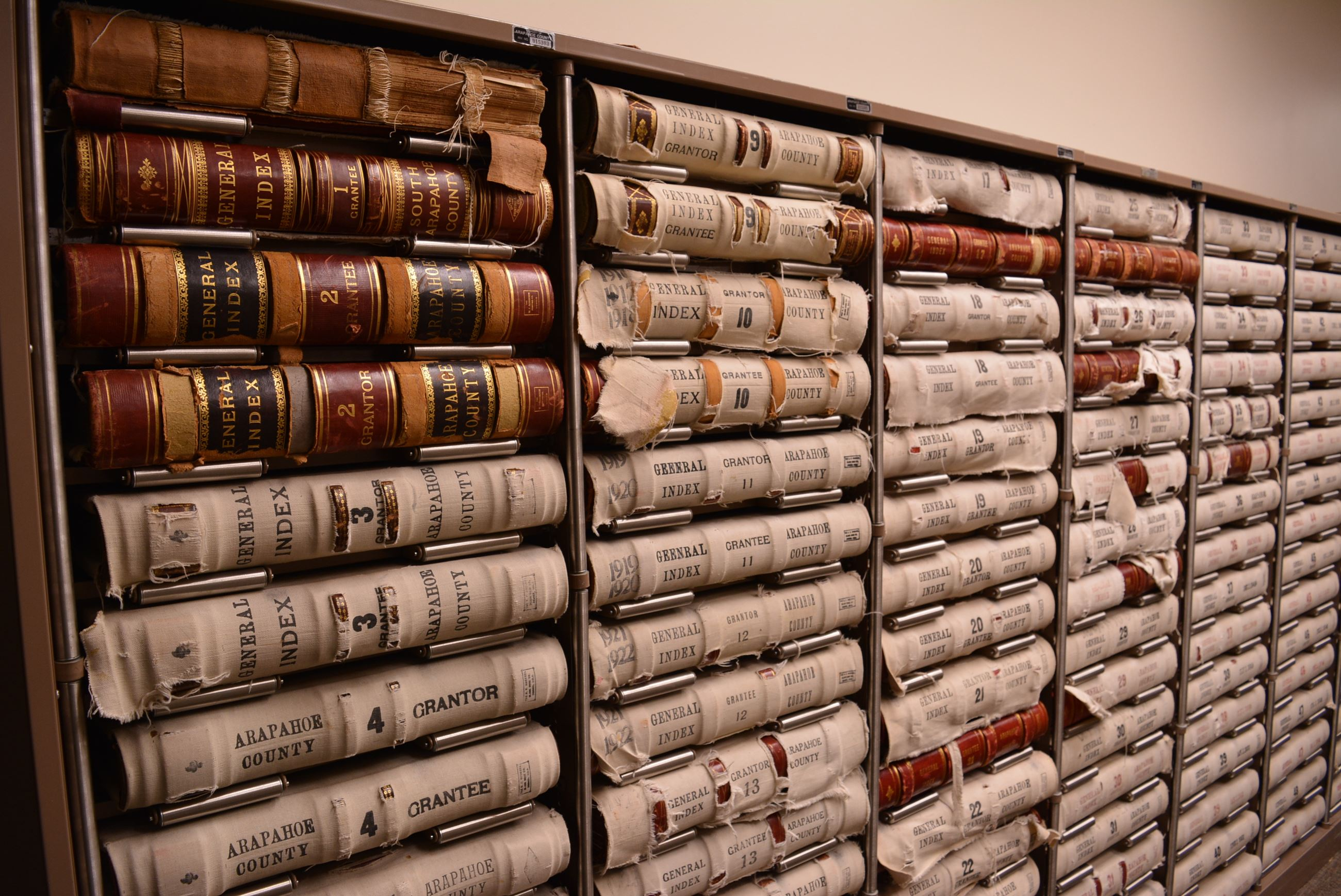 Shelves of Historical Record Books from the 1900s