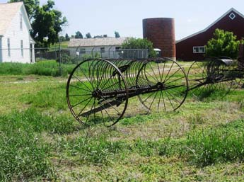 This image shows an old hay rake at the 17 Mile House.